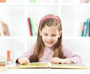 Happy child learning to read